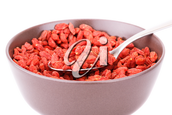 Goji berries in brown bowl on white background.