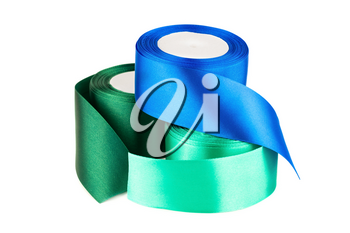 Green and blue silk ribbon reels isolated on white background.