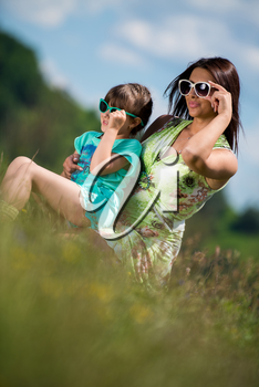 mother and daughter wearing sunglasses