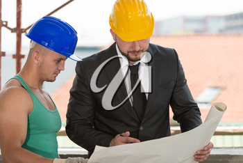 Group Of Male Architect And Construction Worker On Construction Site