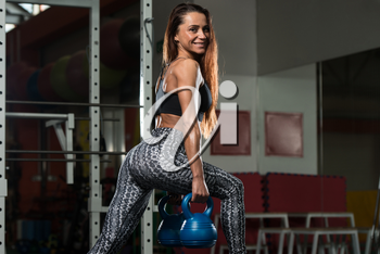 Fitness Woman Working Out Legs With Kettle Bell