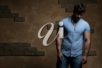 Portrait of Handsome Bearded Man Dressed in Fashionable Clothes Standing Against Wall Background With Area for Advertising Content - Hipster Guy Posing on Copy Space
