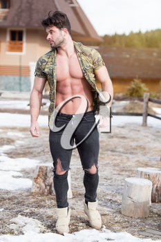 Portrait of a Young Physically Fit Man Showing His Well Trained Body While Wearing Black Jeans - Muscular Athletic Bodybuilder Fitness Model Posing Outdoors - a Place for Your Text