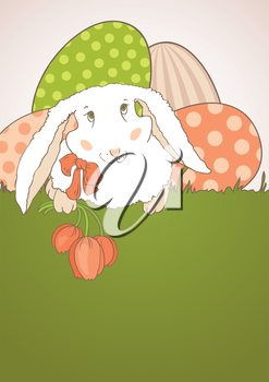Easter bunny with tulips on the grass