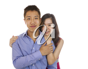 horizontal photo of a young adult couple holding each other while smiling isolated on white