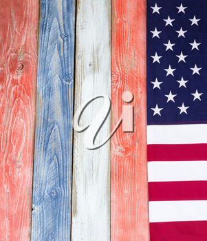 USA flag border on vertical rustic painted wooden boards in national colors of country.