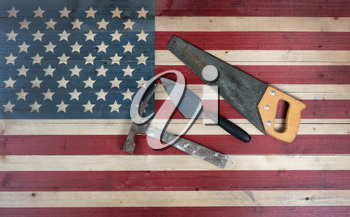 Labor Day background with USA rustic wooden flag and used industrial tools