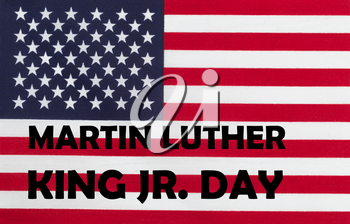 Happy Martin Luther King JR Day background with letters and USA flag