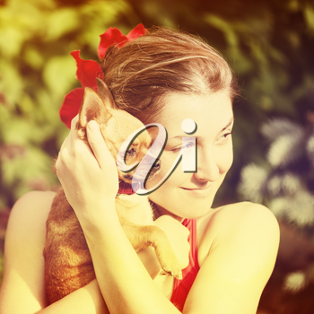 Cute Girl and Her Chihuahua Dog on Nature Background. With Retro Vintage Instagram Filter