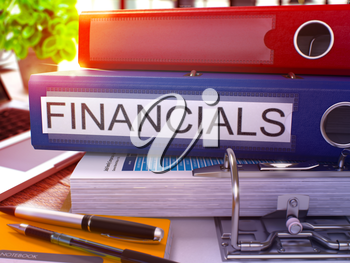 Blue Office Folder with Inscription Financials on Office Desktop with Office Supplies and Modern Laptop. Financials Business Concept on Blurred Background. Financials - Toned Image. 3D Render.