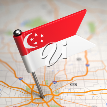 Small Flag of Singapore on a Map Background with Selective Focus.