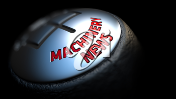 Machinery News. Shift Knob with Red Text on Black Background. Close Up View. Selective Focus. 3D Render.