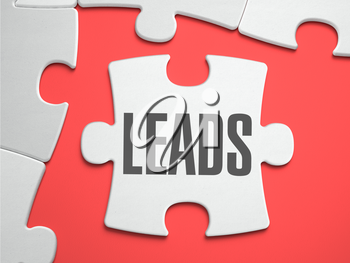 Leads - Text on Puzzle on the Place of Missing Pieces. Scarlett Background. Close-up. 3d Illustration.