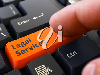 Computer User Presses Orange Button Legal Services on Black Keyboard. Closeup View. Blurred Background.