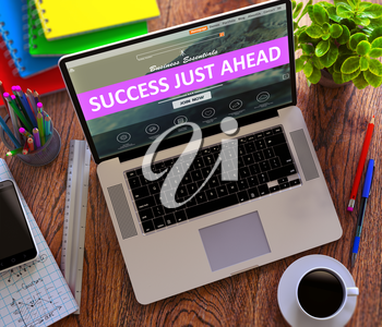 Success Just Ahead Concept. Modern Laptop and Different Office Supply on Wooden Desktop background.