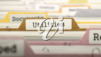 Utilities on Business Folder in Multicolor Card Index. Closeup View. Blurred Image.