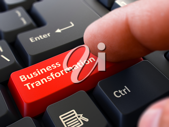 Business Transformation - Written on Red Keyboard Key. Male Hand Presses Button on Black PC Keyboard. Closeup View. Blurred Background.