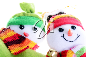Macro shot of two snowmen isolated on a white background
