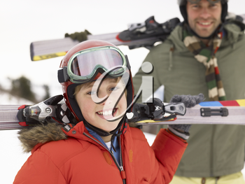 Pre-teen Boy With Father On Ski Vacation