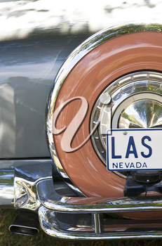 The back end of an American car from the 1950's showing a Las Vegas Nevada registration