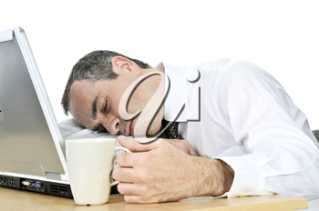 Tired businessman asleep at his desk isolated on white background