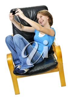 Young girl taking picture of herself in leather chair