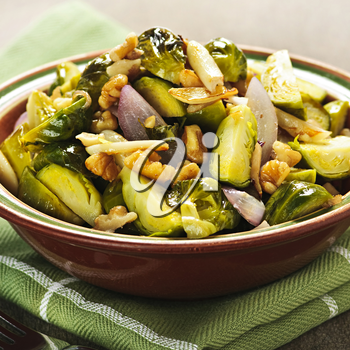Vegetarian bowl of roasted brussels sprouts with walnuts