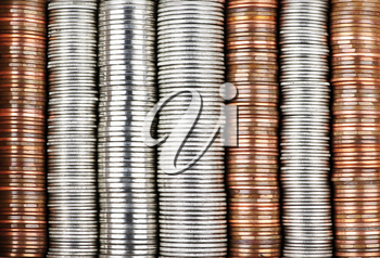Background of penny nickel dime and quarter stacked coins