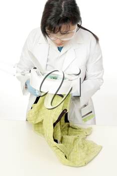 a forensic scientist examines evidence under a magnifying lamp.  Collection samples can  include skin, hair, blood, dirt, fibres, gunshot residue,   etc...