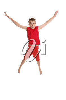 Starjump.  A young boy jumps into the air