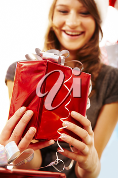 Portrait of smiling woman giving a present