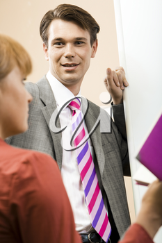 Portrait of smart businessman looking at his partner during presentation