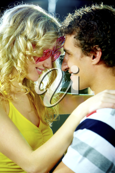 Portrait of happy couple looking at each other and smiling