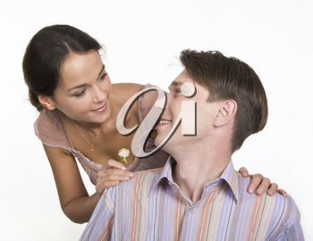 Pretty girl putting her hands on boyfriend�s shoulders and both smiling