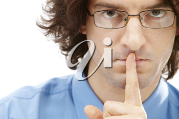 Portrait of serious businessman with glasses holding his finger over the mouth