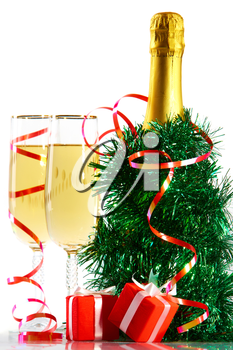 A bottle of champagne in spangle with two full glasses and small gift boxes