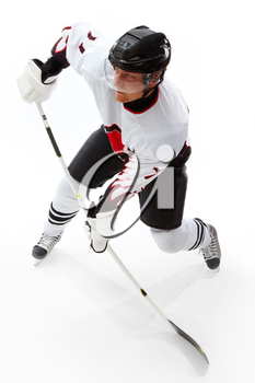 Portrait of healthy sportsman playing hockey on ice