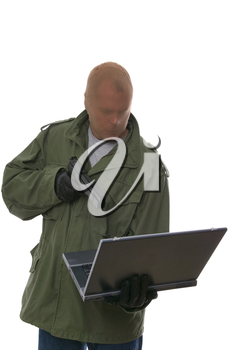 Bank robber aiming a handgun at a laptop. Concept of Internet bank robbery, Identity fraud, Corporate theft etc. Isolated on white.