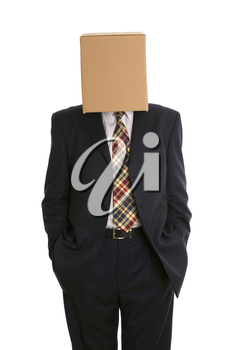 An anonymous businessman with a box on his head and hands in pockets.