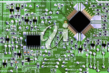 Close up of a circuit board and computer chips.