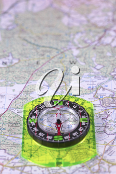 Compass on a map, focus on North.Compass in lower part of image.
