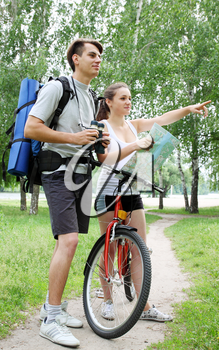 traveler asks for directions from a cyclist