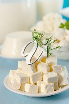 Feta cheese cut into slices on a plate
