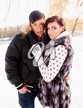 Young beautiful couple on nature in winter