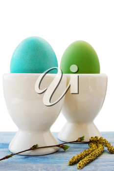 two eggs in a white ceramic stand on the board