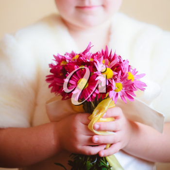 Little Girl With Pink Flowers Asters In Their Hands