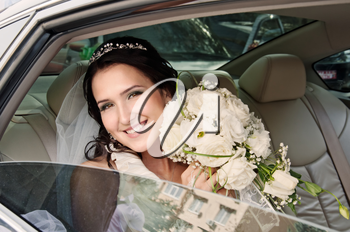 happy bride looking out of car window. Wedding Day