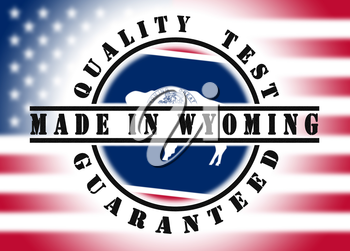 Quality test guaranteed stamp with a state flag inside, Wyoming