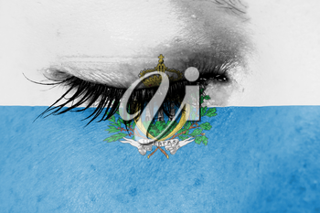 Crying woman, pain and grief concept, flag of San Marino