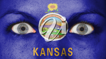 Close up of eyes. Painted face with flag of Kansas